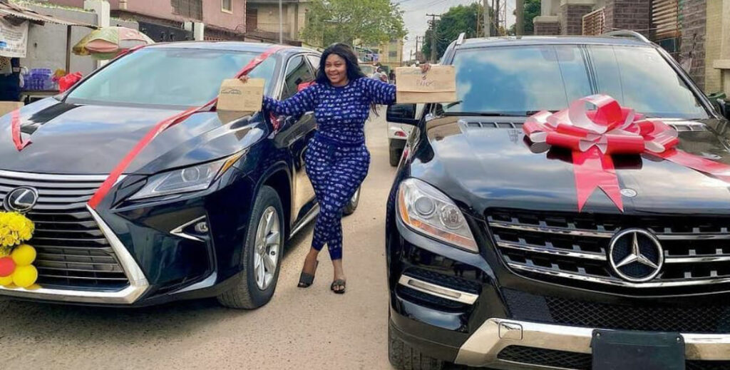 Omoborty gets huge money cake, car gift alongside one she bought with her money (photos)