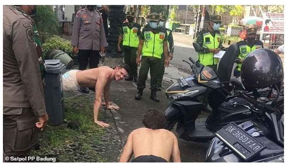 Foreigners without face masks punished with push-ups in Indonesia