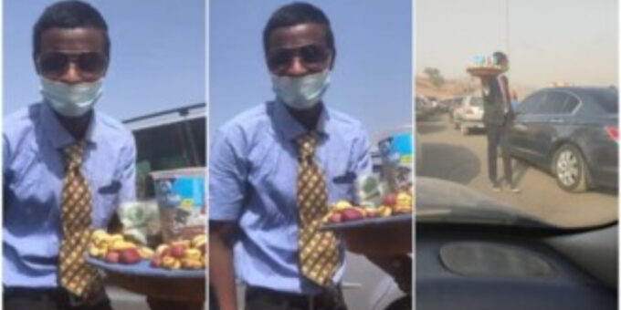 Young man in suit and tie hawk nuts, sweets in traffic, video goes viral
