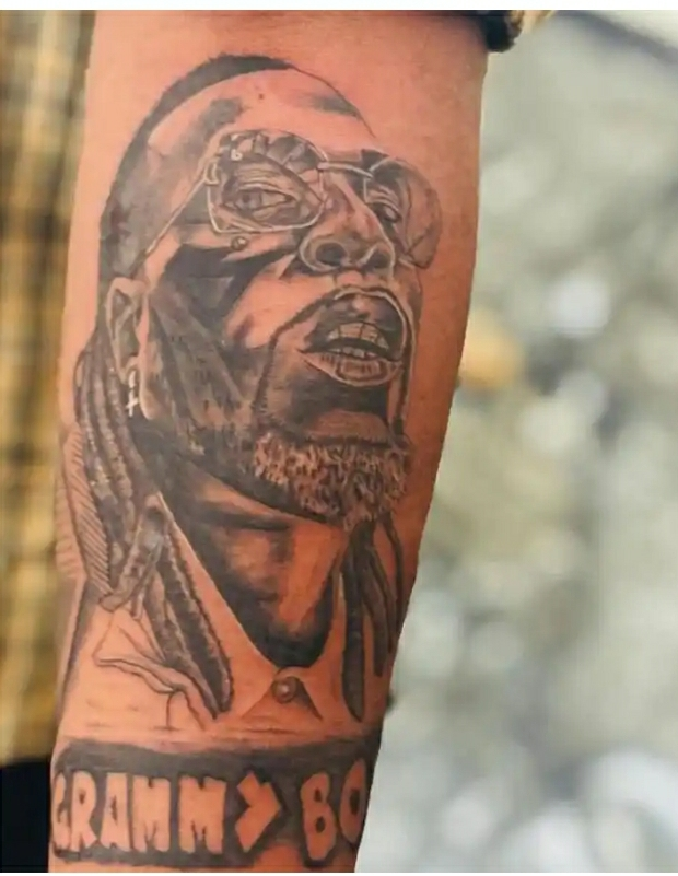 """""""Grammy Boy"""" – Fan Inks Tattoo Of Burna Boy In Honor Of Grammy Win"""