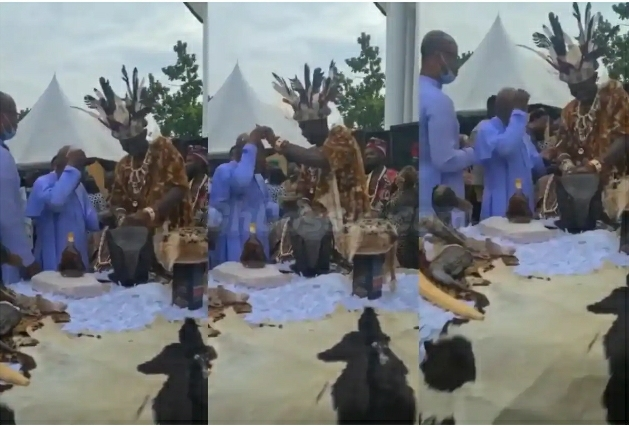 VIDEO: Traditional Ruler Spotted Spraying Dollars On A Rev. Father At Obi Cubana's Mother's Burial
