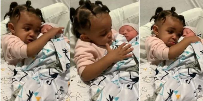 Video shows girl getting emotional as she meets her baby bro for the 1st time