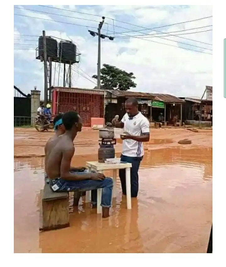 Youths Cook And Swim In Muddy Water To Raise Awareness About The Poor State Of A Road In Imo State (Photos)