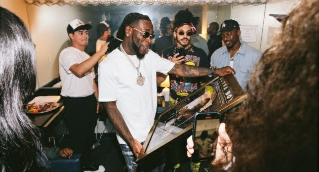 Burna Boy Receives Plaque From Audiomack For Hitting Over 300 Million Streams [Photo]